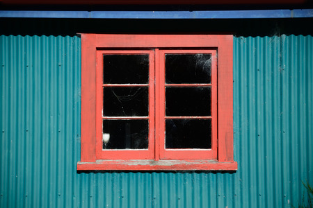 galvanised: Background shot of a window in a colourful old farm building Stock Photo