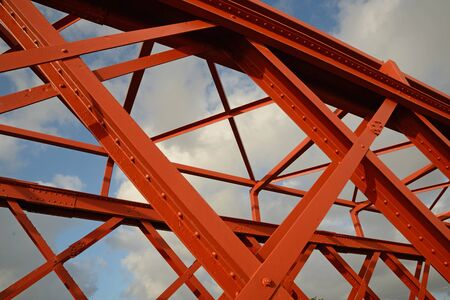 Background of steelwork in a large truss bridge