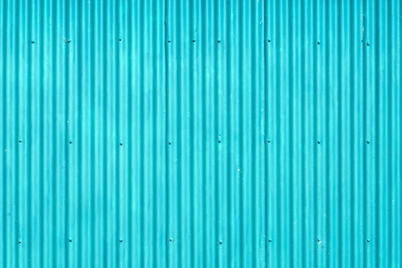 galvanised: Background shot of a wall on a colourful old farm building