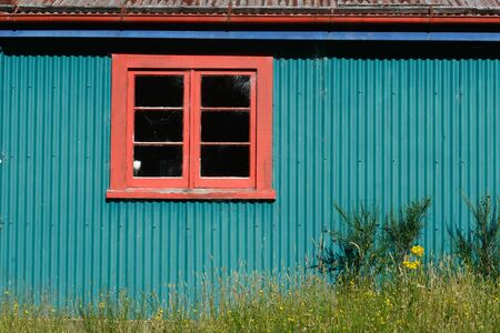 gaudy: Background shot of a window in a colourful old farm building Stock Photo