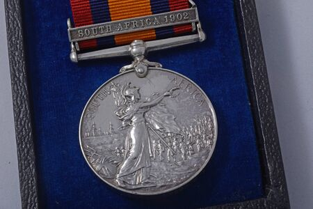 boer: KINGAROY, AUSTRALIA, MARCH 29, 2016: A silver Queens South Africa Medal issued for service in the Boer War, and awarded to a soldier who fought in the South Africa campaign in 1902.