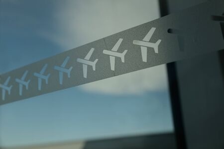 Aeroplane stencils decorate a departure lounge Imagens