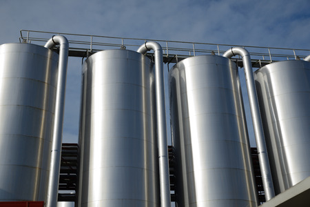 Storage silos contain cleaning chemicals for a milk factory Stock Photo
