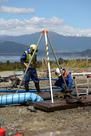 Engineers set up a rescue tripod at the top of an abandoned oil well on the West Coast before sending workers into a  confined space.