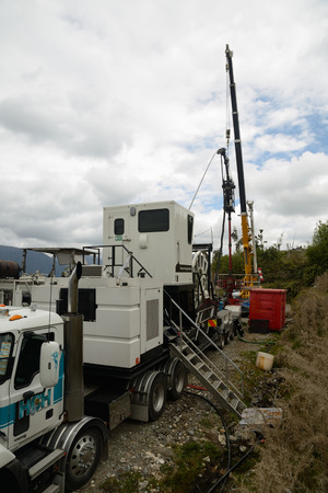 MOANA, NEW ZEALAND, OCTOBER 27, 2017: Well engineers pump concrete into an 850m deep oil well to seal off seepage from the oil bearing strata. The well was uneconomical.