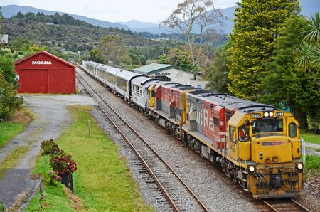 MOANA, NEW ZEALAND, APRIL 23, 2018: A passenger train, the Tranz Scenic, pauses at the Moana Railway station for passengers to disembark. Editorial