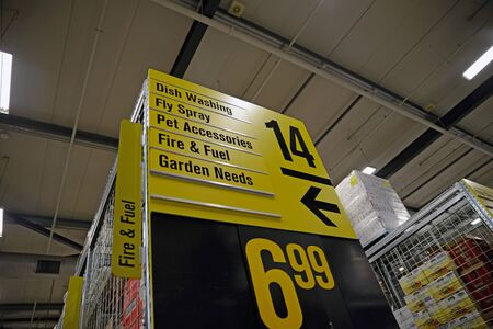 NELSON, NEW ZEALAND, JULY 19, 2018: Bold signage directs customers to examine sale goods in a supermarket. Editorial