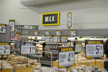 NELSON, NEW ZEALAND, JULY 19, 2018: Unidentified customers examine sale goods in a supermarket.