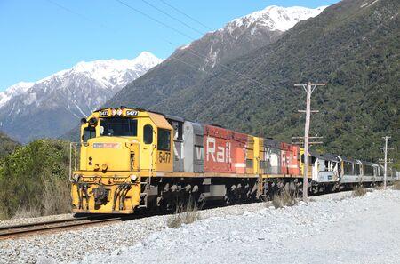 OTIRA, NEW ZEALAND, SEPTEMBER 6, 2018: A passenger train, the Tranz Scenic, navigates the Southern Alps near Otira, New Zealand.