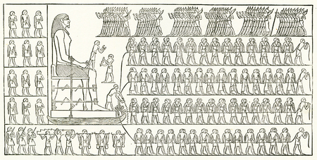 Engraving of teams of workers or slaves shifting a gigantic statue or colossus in Ancient Egypt. From an original engraving in the 1895 edition of Graven in the Rock, by Samuel Kinns