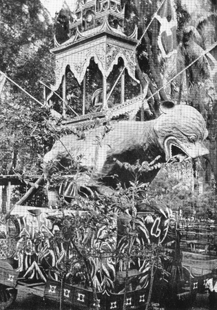Halftone of the funeral car, or pongyi byan, for a buddhist monk in Burma, circa 1890. The coffin sits above the figure of a tiger eating a deer. From Judson, the hero of Burma, 1923