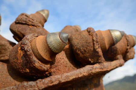 Detail of the teeth on an underground coal mining machine displayed in a park at Ranunga, West Coast, New Zealand