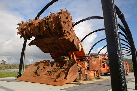 An underground coal mining machine on display in a park at Ranunga, West Coast, New Zealand