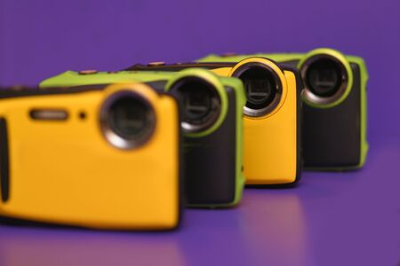 A lineup of new coplourful yellow and green waterproof cameras 스톡 콘텐츠