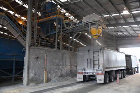 CHRISTCHURCH, NEW ZEALAND, DECEMBER 12, 2018: A tip truck loads up with bulk fertiliser Editoriali