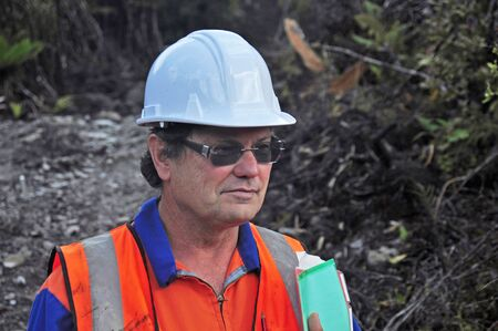 Portrait of a geologist inspecting a seismic line in New Zealand Banco de Imagens