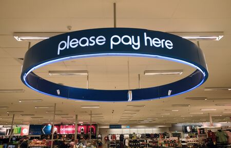 TOOWOOMBA, AUSTRALIA, JULY 27, 2019: Signage in a large department store directs customers to the checkout