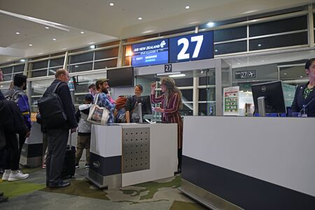 CHRISTCHURCH, NEW ZEALAND, JULY, 2019: passengers board an Air New Zealand flight to Melbourne at gate 27