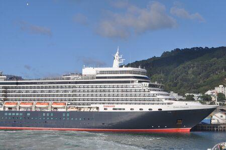 TAURANGA NEW ZEALAND, FEBRUARY 9, 2020: The Queen Elizabeth rests at her moorings in Tauranga, New Zealand, February 9, 2020.