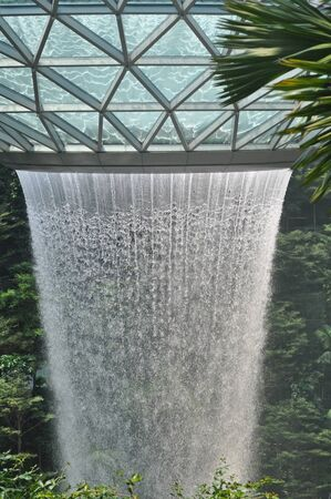 SINGAPORE, JANUARY 17, 2019: Detail of  the waterfall at  Jewel Changi Airport in Singapore