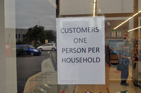 GREYMOUTH, NEW ZEALAND, APRIL 11, 2020: A supermarket in Greymouth restricts dustomer numbers during the Covid 19 lockdown in New Zealand, April 11,  2020