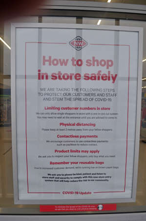 GREYMOUTH, NEW ZEALAND, APRIL 11, 2020: Supermarket signage outlines business rules during the Covid 19 lockdown in New Zealand, April 11,  2020