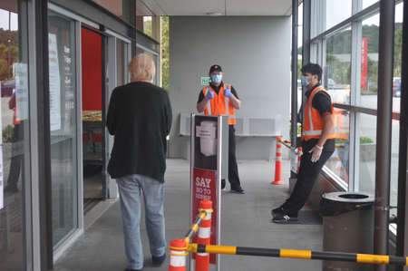 GREYMOUTH, NEW ZEALAND, APRIL 11, 2020: Supermarket staff greet a customer during the Covid 19 lockdown in New Zealand, April 11,  2020