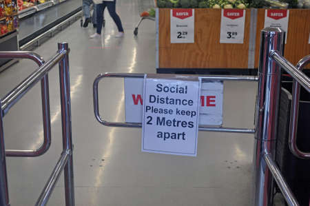GREYMOUTH, NEW ZEALAND, APRIL 11, 2020: Signage at a supermarket in Greymouth warns customers to keep their social distancing during the Covid 19 lockdown in New Zealand, April 11,  2020