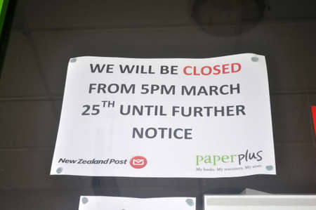 GREYMOUTH, NEW ZEALAND, APRIL 11, 2020: Signage on a business closed down for the Covid 19 lockdown in New Zealand, April 11,  2020
