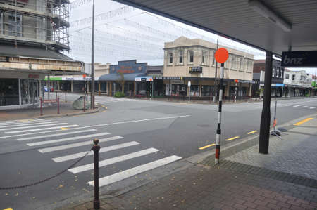 GREYMOUTH, NEW ZEALAND, APRIL 11, 2020: Mackay Street, normally a busy thoroughfare on a Saturday morning, is empty during the Covid 19 lockdown in New Zealand, April 11,  2020