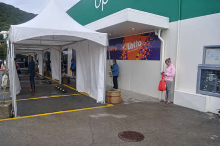 GREYMOUTH, NEW ZEALAND, APRIL 18, 2020: Customers wait outside a supermarket following social distancing regulations during the Covid 19 lockdown in New Zealand, April 18,  2020 Editorial