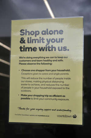 GREYMOUTH, NEW ZEALAND, APRIL 18, 2020: Signage outside a supermarket encourages social distancing regulations during the Covid 19 lockdown in New Zealand, April 18,  2020