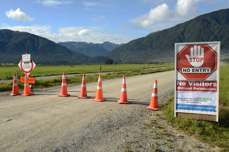 Signage shows that a farm has restricted access during the Covid 19 lockdown in New Zealand, March 2020