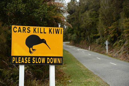 A road sign warns drivers to beware of Kiwi as they drive into Okarito in New Zealand's South Island
