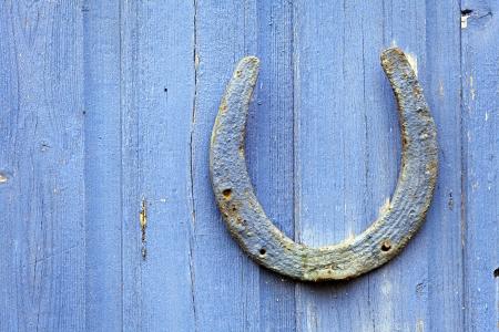 nailed: Lucky Horseshoe nailed to door