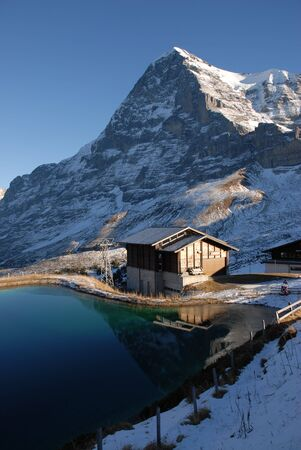 berner: Eiger north face with small lake.