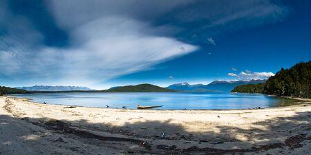 new zealand beach: lake manapouri on kelper track, south island, new zealand