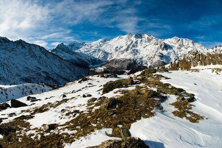 saas fee: Panorama of Saas Fee mountain range (Allalinhorn, Alphubel, Taeschhorn, Dom). View from Kreuzboden, Switzerland. Stock Photo