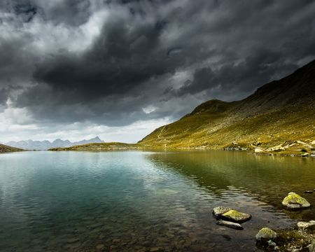 Mountain lake with storm and dark clouds, Engadin, Switzerland