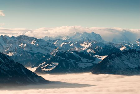 View of swiss mountains above the clouds in winter, View from Rigi, Switzerland