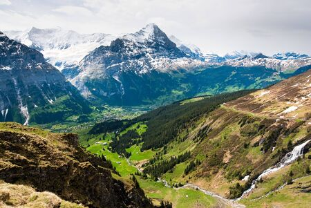 eiger: scenic view over grindelwald with Eiger mountain peak in spring, Switzerland