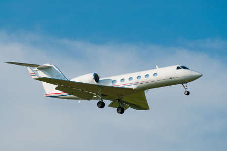 small private jet landing with gears down Stock Photo - 4844078