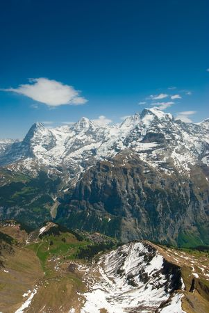 Eiger Moench and Jungfrau mountain peaks, view from Schilthorn, Switzerland photo