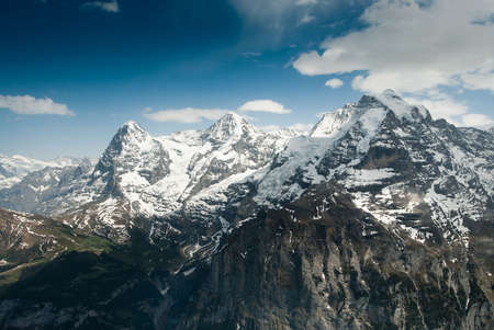 Eiger, Monch and Jungfrau mountain, view from Schilthorn, Switzerland photo