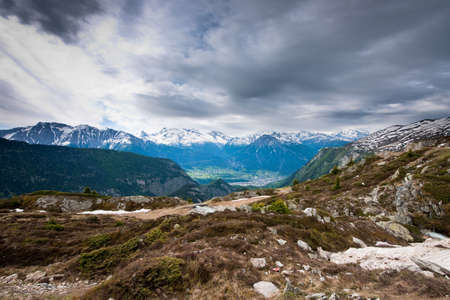 brig: scenic view from belalp, wallis, switzerland on a gray day