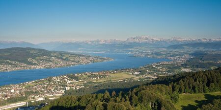scenic view from uetliberg, zürich, switzerland with lake zurich and mountains on a clear day
