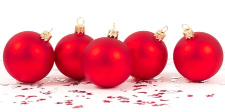 red christmas balls with silver stars on white background