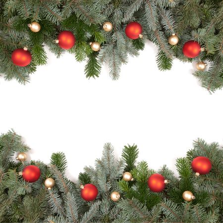 green fir twig frame with christmas balls on white background photo