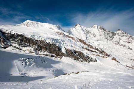 saas fee: Scenic view from Mittelallalin of mountain peaks (Alphubel, Dom, Taeschorn) at Saas Fee in winter, Switzerland