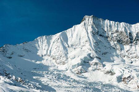 saas fee: Taeschorn mountain peak in Winter, Saas Fee, Wallis, Switzerland Stock Photo
